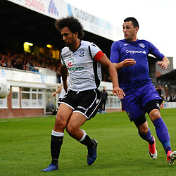 TELFORD COPYRIGHT MIKE SHERIDAN Josh Gowling of Hereford hokds off Aaron Williams of Telford during the National League North fixture between Hereford FC and AFC Telford United at Edgar Street, Hereford on Tuesday, August 13, 2019<br /> <br /> Picture credit: Mike Sheridan<br /> <br /> MS201920-009