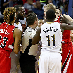 Mar 18, 2016; New Orleans, LA, USA; New Orleans Pelicans center Kendrick Perkins (5) and Portland Trail Blazers center Mason Plumlee (24) get into a scuffle following a foul during the second half of a game at the Smoothie King Center. The Trail Blazers defeated the Pelicans 117-112.  Mandatory Credit: Derick E. Hingle-USA TODAY Sports