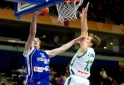 Petteri Koponen of Finland vs Zoran Dragic of Slovenia during basketball game between National basketball teams of Slovenia and Finland at FIBA Europe Eurobasket Lithuania 2011, on September 12, 2011, in Siemens Arena,  Vilnius, Lithuania.  Slovenia defeated Finland 67-60. (Photo by Vid Ponikvar / Sportida)