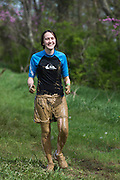 A participant finishes the rest of the O'Bleness Race for a Reason Mud Run after completing the old Army ROTC training course located at the Ridges, Saturday, April 27, 2013. The course included a four-mile run up to the old Army ROTC Course at the Ridges, through the Radar Hill Trail and back to Tail Great Park across from Peden Stadium. Race for a Reason, Race 4 A Reason, Annual Events, Events, Students, Faculty & Staff