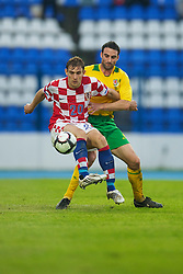 OSIJEK, CROATIA - Sunday, May 23, 2010: Wales' Craig Morgan and Croatia's Nikica Jelavic during the International Friendly match at the Stadion Gradski Vrt. (Pic by David Rawcliffe/Propaganda)