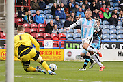 Huddersfield Town defender Joel Lynch (33)  watches the ball back to Huddersfield Town goalkeeper, on loan from Aston Villa, Jed Steer (1) during the Sky Bet Championship match between Huddersfield Town and Sheffield Wednesday at the John Smiths Stadium, Huddersfield, England on 2 April 2016. Photo by Simon Davies.