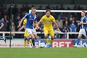 AFC Wimbledon midfielder Dannie Bulman (4) closed own Rochdale FC defender Jim McNulty (4) during the EFL Sky Bet League 1 match between Rochdale and AFC Wimbledon at Spotland, Rochdale, England on 27 August 2016. Photo by Stuart Butcher.
