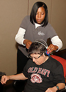 Dr. Lakisha Williams of Dayton removes the headphones following a hearing screening during the 10th Annual Celebrating life & health free community health fair at Sinclair's Ponitz Center in downtown Dayton, Saturday, April 21, 2012. More than 50 vendors were spread over three floors providing vision, hearing, blood pressure and other screenings, health information and entertainment.