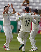 Graham Onions (Durham County Cricket Club) celebrates taking the wicket of Sam Hain(Warwickshire County Cricket Club)  with Ryan Pringle (17) and Scott Borthwick  (16) during the LV County Championship Div 1 match between Durham County Cricket Club and Warwickshire County Cricket Club at the Emirates Durham ICG Ground, Chester-le-Street, United Kingdom on 15 July 2015. Photo by George Ledger.