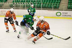SELAN Maks of HK SZ Olimpija na Tommaso Traversa of Rittner Baum during hockey match between HK SZ Olimpija (SLO) and Rittner Buam (ITA) in 1st round of Alps Hockey League 2017/18, on September 13, 2017 in Tivoli, Ljubljana, Slovenia. Photo by Urban Urbanc / Sportida