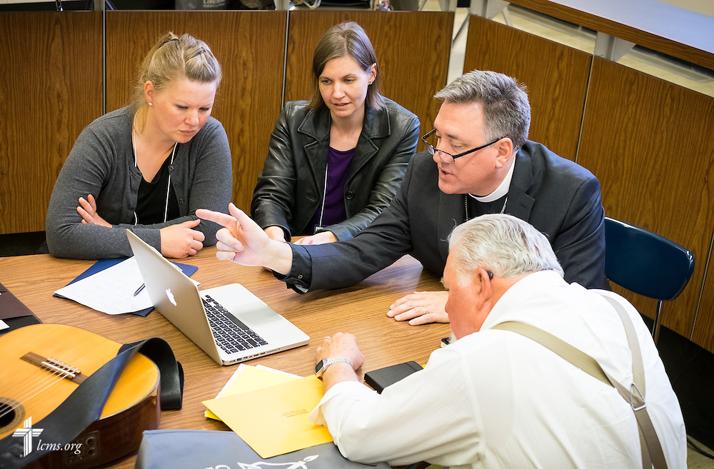 """The Rev. Dr. Jon Vieker mentors (from L-R) Katie Schuermann, Dr. Rebecca Abbott and the Rev. Dr. Fred Baue in the art of writing hymns at the """"Fresh Hymns of Thankful Praise"""" symposium at Concordia Theological Seminary in Fort Wayne, Ind."""