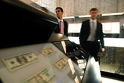 Visitors look at displays of the US currencies in the Museum of American Finance in New York, New York, USA, 22 October 2008. As Wall Street descend into a financial turmoil not seen since the stock market crash of 1929 and financial businesses were pommeled into rampant sell-offs in stocks and face regulatory changes to their business practices, professionals and non-professionals working in the district's banks, stock-trading houses and insurance companies are showing stress and a gloom not unlike the times of the Great Depression.