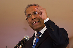 © Licensed to London News Pictures. 01/05/2015. London, UK. Ex Mayor of Tower Hamlets, Lutfur Rahman speaking at a public meeting held at the Waterlily in Stepney, east London on 30th April 2015. The meeting was ex Mayor of Tower Hamlets, Lutfur Rahman's first public appearance after being found guilty of electoral fraud last week and called for attendees to donate money to a legal fund to facilitate an appeal against the High Court ruling. Photo credit : Vickie Flores/LNP