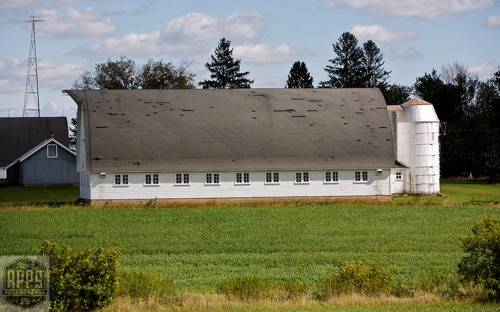 A collection of Barns that still can be seen while traveling the countryside in  the beautiful State of Wisconsin.<br /> Baron County- Barn with arched roof wooden silo- west side of County O &amp; 18 Ave, south of Rice lake. Barns from around the State of Wisconsin.