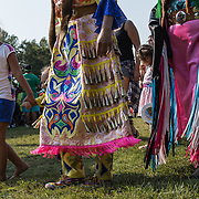 Three generations dancing at a Native American Pow Wow.