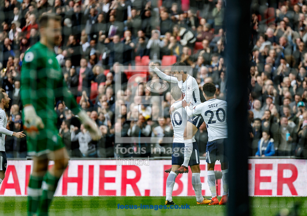Son Heung-Min of Tottenham Hotspur celebrates his goal while Goalkeeper Simon Mignolet of Liverpool walks back to collect the ball during the Premier League match at Wembley Stadium, London<br /> Picture by Liam McAvoy/Focus Images Ltd 07413 543156<br /> 22/10/2017