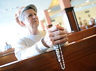 POPESHRINE20P<br /> Mary Jane Hitchman, of Telford, Pennsylvania holds rosary beads as she prays during 11:30am mass at the National Shrine of Our Lady of Czestochowa Monday September 14, 2015 in Doylestown, Pennsylvania. Pope Francis will visit Philadelphia September 26 and 27th. (William Thomas Cain/For The Inquirer)