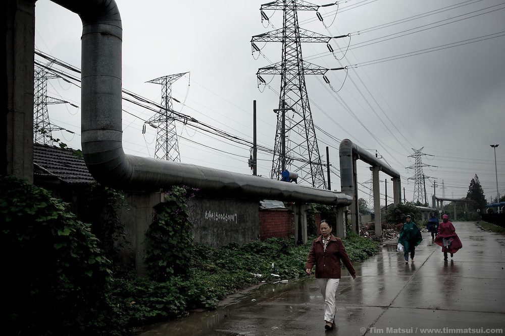 Pipes and transmission lines outside a coal fired power plant in Yangzhou, China, a suburb city of Shanghai and major producer of photovoltaic cells for solar power.