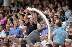 © Licensed to London News Pictures. 25/08/2013. London, UK Investec 5th Ashes Test, The Kia Oval, 5th day, 25/08/2013 Cricket fans play with empty beer cups.. Photo credit : Mike King/LNP