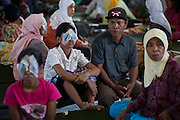 "June 2011 Cataract Operation in P. Sidempuan and Medan, Indonesia by SusilawatyThe Story of Maslia and Nurasni LubisMaslia Lubis 15 and her sister Nurasni 19 are from jalan Sibolga, Desa (village) Sipenggeng in Batang Toru, 26kms from Padang sidempuan in North Sumatra,They were bilateral blind, means blind in both eyes. Cause of their blindness is cataract, a disease curable by an eight-minute operation. Yet Maslia had been blind since she was 3, and Nurasni since 5.Maslia's poor vision was noticed by her parents when she a toddler, she could not find toys she was playing with after they were dropped.Even with her impaired vision, Maslia is determined to continue studying and is a smart student. She is in secondary 3 (SMP 3), and although she can't see or write, she can hear and speak. She managed to be ranked 3rd in her class on her academic results.But it is difficult for her to enjoy school activities. She can't participate in sports. And she can't go to school on her own. She needs school mates' help.Maslia was always hopeful to regain her sight and often asked her parents to take her to clinics. But all the clinics they'd been could not cure her.Her parents (Sari Alam and Mara Aman Lubis), who rely on farming income from a quarter hectare land to feed a family of 6, could not afford to keep on spending on experimental treatment.Whilst Maslia is a confident and hopeful young girl, Nurasni has become the opposite.Constant teasing by friends calling her ""blind girl"" and inability to keep up with school her led to a low self-esteemed. Nurasni eventually dropped out of school after Primary 5 (SD 5). She had also somehow, accepting her fate. She never asked her parents to take her to clinics.Dr. Sanduk Ruit of Tilganga Institute of Ophthalmology - Nepal, operated both girls on The 16th June 2011 at the Military Hospital in Padang Sidempuan.Their vision was restored the very next day.Visiting the market and buying a purple dress are high on their to-do-list now that t"