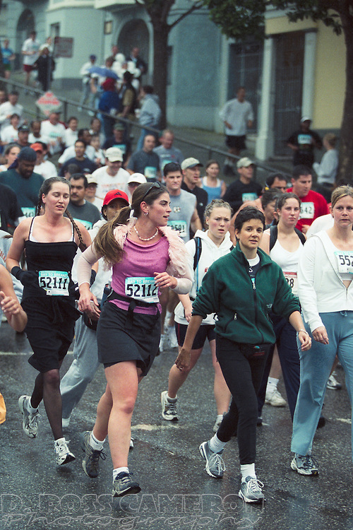 Emily Corwin (52111) and Maryanne Hulsman (52112) dress for success at the 91st running of the Bay to Breakers 12K race, Sunday, May 19, 2002 in San Francisco. (Photo by D. Ross Cameron)