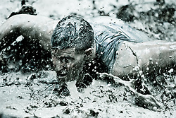 Over 1,200 teams of four compete in the 2011 Ulitmate Challenge USMC Mud Run Saturday in Columbia. The USMC Mud Run is the largest mud run in North America.