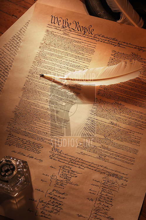 vintage shot of the US Constitution showing the full document wtih quill pen and ink pot