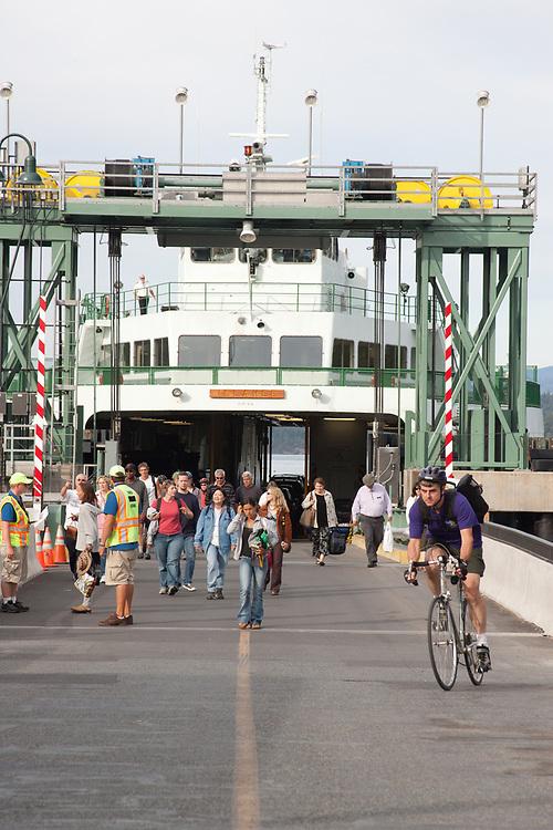 United States, Washington, San Juan Island, Friday Harbor. people leaving ferry at pier at the Port of Friday Harbor.