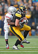 November 20 2010: Iowa Hawkeyes tight end Allen Reisner (82) is hit by Ohio State Buckeyes defensive back Orhian Johnson (19) during the first quarter of the NCAA football game between the Ohio State Buckeyes and the Iowa Hawkeyes at Kinnick Stadium in Iowa City, Iowa on Saturday November 20, 2010. Ohio State defeated Iowa 20-17.