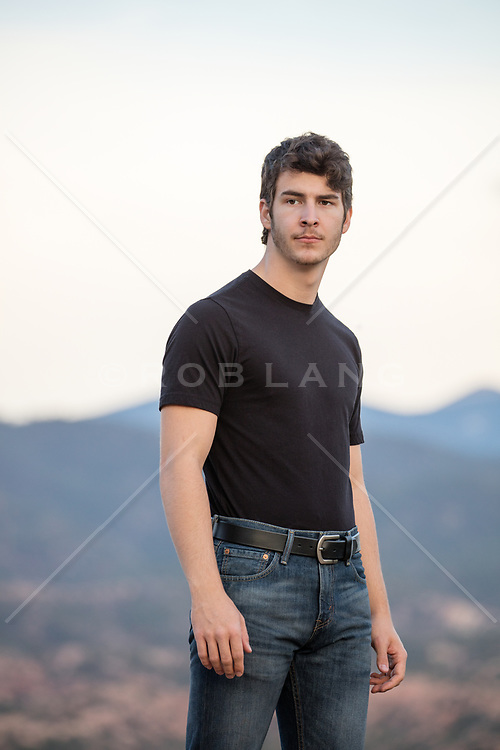 man outdoors by a mountain range