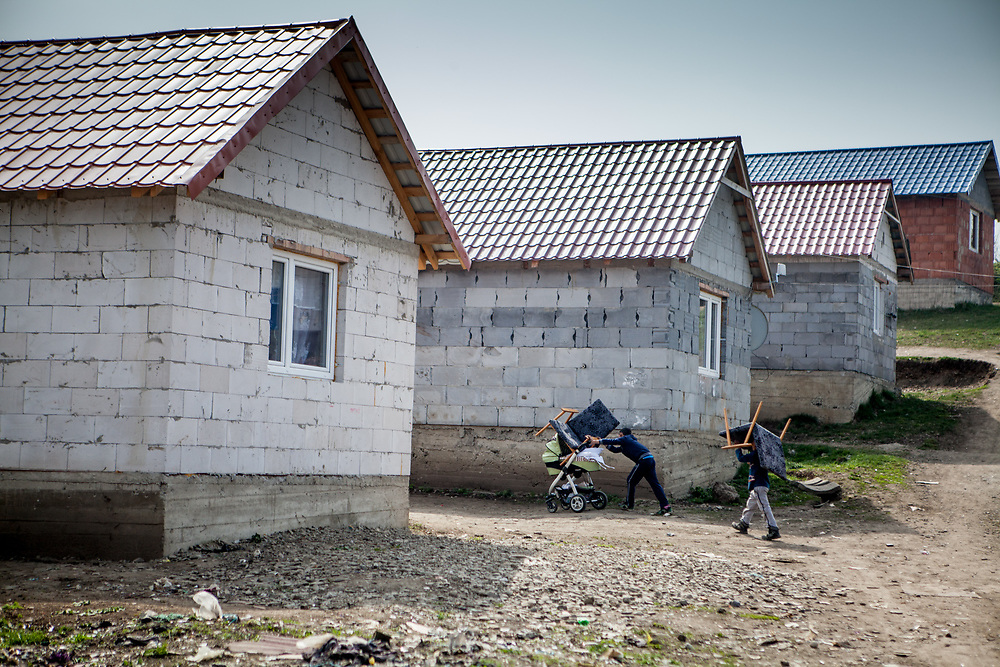 Children are moving furniture at the Roma settlement in Ostrovany.  The variety of housing facilities in the settlement is huge, from little shanties up to new built houses according the possibilities of the inhabitants.