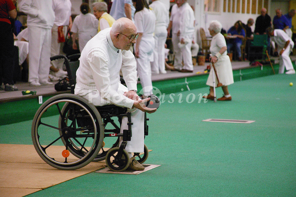 Male wheelchair user taking part in a bowls event held at Solihull Indoor Bowls Centre,