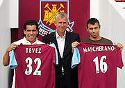 Carlos Tevez and Javier Mascherano pose with Boss Alan Pardew at their press conference at Upton Park.
