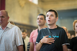"""3 June 2018, Novi Sad, Serbia: A differently abled person attends Sunday service in the Eastern Orthodox Cathedral Church of the Holy Great Martyr George. On 31 May - 6 June 2018, in Novi Sad, Serbia, the Serbian Orthodox Church stood as one of the host churches of the Conference of European Churches General Assembly. More than 400 delegates, advisors, stewards, youth, staff, and distinguished guests took part in the Assembly and related events, gathered under the theme, """"You shall be my witnesses""""."""