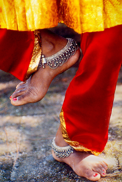 The feet of classical Nepali dancer Kanayah Shrestra adorned with silver anklets during a sacred dance re-enacting the creation of the Kathmandu Valley by the gods.