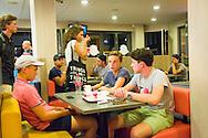 Nederland, Den Bosch, 20160719.<br /> In de friettent Kees Kroket in Den Bosch.<br /> Jongeren aan een tafeltje. Chillen met friet en snacks<br /> <br /> Netherlands, Den Bosch