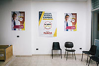 TARANTO, ITALY - 22 FEBRUARY 2018: Five Stars Movement elections posters are seen here in the local headquarters of the movement in the working-class district of Tamburi, in Taranto, Italy, on February 22nd 2018.<br /> <br /> Taranto, a  formerly lovely town on the Ionian Sea has for the last several decades been dominated by the ILVA steel mill, the largest steel plant in Europe. It was built by the government in the 1960s as a means of delivering jobs to the economically depressed south, but has been implicated for a cancer as dioxin and mercury have seeped into local groundwater, tainting the food supply, while poisoning the bay and its once-lucrative mussels.
