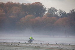 © Licensed to London News Pictures. 18/12/2019. London, UK. Cyclists enjoy a frosty and foggy morning in Richmond Park this morning as weather experts predict a sunny day followed by rain and wind for the State opening of Parliament on Thursday . Photo credit: Alex Lentati/LNP