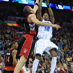 06 February 2009:  New Orleans Hornets guard Antonio Daniels (50) shoots over Toronto Raptors guard Anthony Parker (18) during a 101-92 win by the New Orleans Hornets over the Toronto Raptors at the New Orleans Arena in New Orleans, LA.