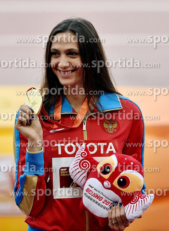 30-08-2015 CHN: IAAF World Championships Athletics day 9, Beijing <br /> Huldiging hoogspringen Maria Kuchina RUS goud<br /> Photo by Ronald Hoogendoorn / Sportida