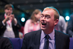 © Licensed to London News Pictures . 07/10/2014 . Glasgow , UK . TIM FARRON , President of the Liberal Democrats and MP for Westmorland and Lonsdale , sits as the audience applaud his speech to the conference . The Liberal Democrat Party Conference 2014 at the Scottish Exhibition and Conference Centre in Glasgow . Photo credit : Joel Goodman/LNP