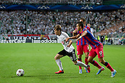 (L) Legia's Jakub Kosecki fights for the ball with (R) Steaua's Daniel Georgievski during the UEFA Champions League play-off second leg match between Legia Warsaw and FC Steaua Bucuresti at Pepsi Arena Stadium in Warsaw on August 27, 2013.<br /> <br /> Poland, Warsaw, August 27, 2013<br /> <br /> Picture also available in RAW (NEF) or TIFF format on special request.<br /> <br /> For editorial use only. Any commercial or promotional use requires permission.<br /> <br /> Photo by &copy; Adam Nurkiewicz / Mediasport
