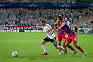 (L) Legia's Jakub Kosecki fights for the ball with (R) Steaua's Daniel Georgievski during the UEFA Champions League play-off second leg match between Legia Warsaw and FC Steaua Bucuresti at Pepsi Arena Stadium in Warsaw on August 27, 2013.<br /> <br /> Poland, Warsaw, August 27, 2013<br /> <br /> Picture also available in RAW (NEF) or TIFF format on special request.<br /> <br /> For editorial use only. Any commercial or promotional use requires permission.<br /> <br /> Photo by © Adam Nurkiewicz / Mediasport