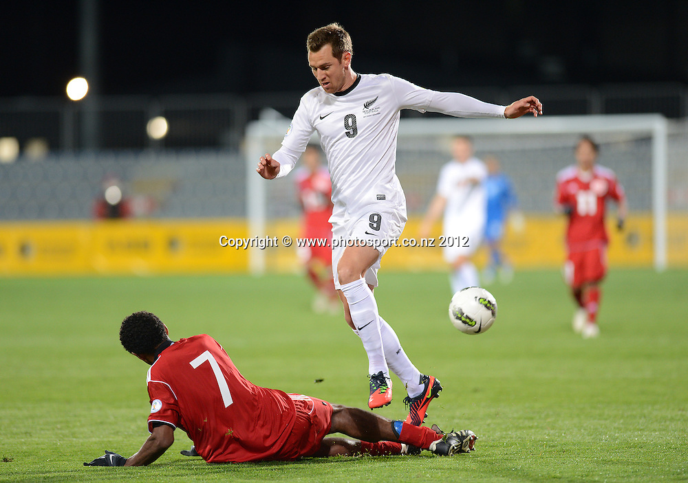 Shane Smeltz goes over the top of Pierre Kugogne. New Zealand All Whites v Tahiti. FIFA World Cup Qualifier Football match at AMI Stadium. Christchurch, New Zealand. Tuesday 16 October 2012. Photo: Andrew Cornaga/photosport.co.nz