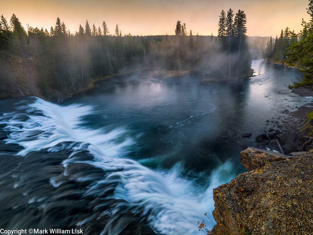 Cave Falls cascades over a sharp basalt ledge, Fall River, Yellowstone National Park.