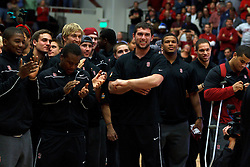 Dec 22, 2011; Stanford CA, USA;  Stanford Cardinal quarterback Andrew Luck (center) and his teammates stand at mid court as the football team was honored at halftime during the mens basketball game against the Butler Bulldogs.  Butler defeated Stanford 71-66. Mandatory Credit: Jason O. Watson-US PRESSWIRE