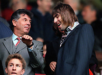 Oasis singer (and Manchester City fan) Liam Gallagher talks with Arsenal vice-chairman David Dein before the match Arsenal v Manchester City, F.A.Carling Premiership, 28/10/2000. Credit Colorsport / Stuart MacFarlane.