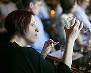 Colleen Brennan-Barry of Rochester examines her glass of whisky at the Suntory Japanese Whisky Dinner at Good Luck in Rochester, part of the weeklong Rochester Cocktail Revival, on Wednesday, May 6, 2015.