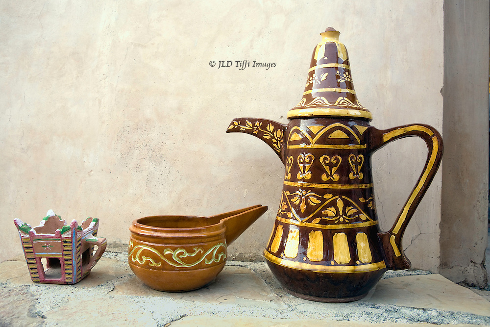 Oman, Nakhl fortress.  Built by Al Arabiyah dynasty imam who threw the Portuguese out of Oman in the 1640s.  Used until the 1950s as the residence of the local wali (governor). Restored in the 1990s. Coffee pot, incense burner, and oil lamp on a shelf near the entrance..