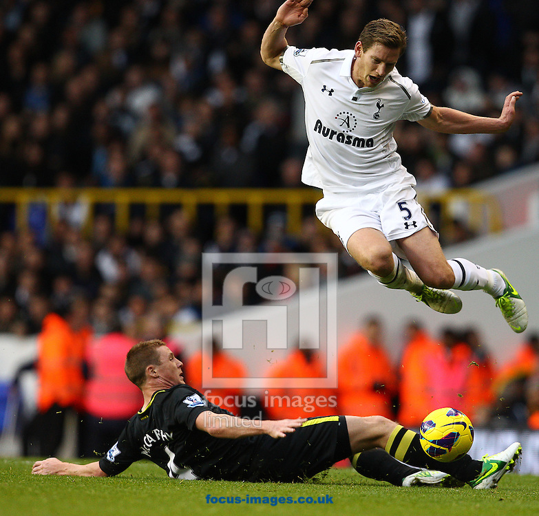 Picture by Paul Terry/Focus Images Ltd +44 7545 642257.03/11/2012.Jan Vertonghen of Tottenham Hotspur is challenged by James McCarthey of Wigan Athletic during the Barclays Premier League match at White Hart Lane, London.