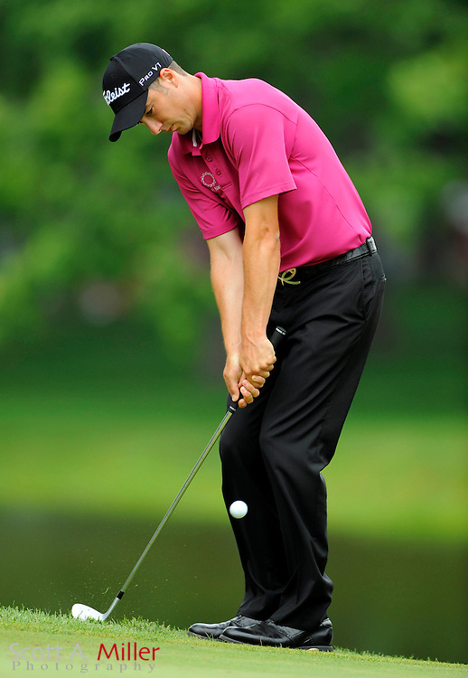 Aug 15, 2009; Chaska, MN, USA; Ross Fisher (GBR) chips onto the 11th green during the third round of the 2009 PGA Championship at Hazeltine National Golf Club.  ©2009 Scott A. Miller