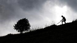 """THEMENBILD - Bergbauern in den Hohen Tauern. Mähen mit der Sense. Die steilsten Hänge am Innermarcherhof in Virgen werden von Altbauer Georg Steiner, vlg. """"Marcha Jörgl"""" und seinem Schwiegersohn Markus nach wie vor von Hand mit der Sense gemäht, Traditionell wie es seit Jahrhunderten auch ihre Vorfahren taten. Der Einsatz von Maschinen ist aufgrund der Steilheit der Hänge nicht möglich. Fotografiert am 04.07.2011. EXPA Pictures © 2011, PhotoCredit: EXPA/ Johann Groder"""