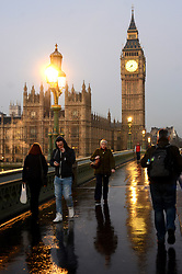 © Licensed to London News Pictures.10/12/2013. London, UK.People make their way across Westminster Bridge this morning.Photo credit : Peter Kollanyi/LNP