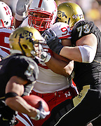 SHOT 11/27/09 2:48:18 PM - Nebraska Cornhuskers defensive tackle Ndamukong Suh (#93) tries to get to the ball carrier during the first half of their game against Colorado at Folsom Field in Boulder, Co. Nebraska won the game 28-20. Suh is one of the top players in the nation, a candidate for the Heisman trophy and a likely top NFL draft pick. (Photo by Marc Piscotty / © 2009)